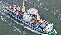 MV Svenja loading living quarter in Rotterdam